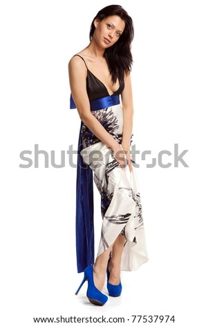 Young sexy woman in evening dress over white background - stock photo