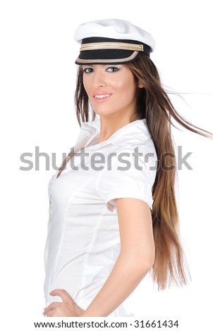 Young sexy woman in navy uniform with hair flying in the wind