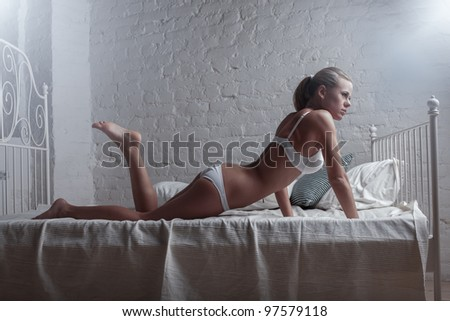 Young sexy woman in white lingerie - stock photo