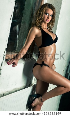 Young sexy woman indoors. Contrast colors. - stock photo