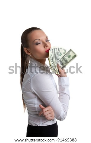 young sexy woman kiss a bundle of dollars