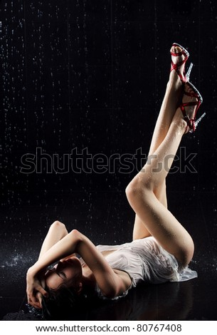 Young sexy woman laying. Water studio photo. - stock photo