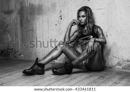 Young sexy woman lying in bed in black white - stock photo