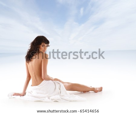 Young sexy woman meditating over sea background - stock photo