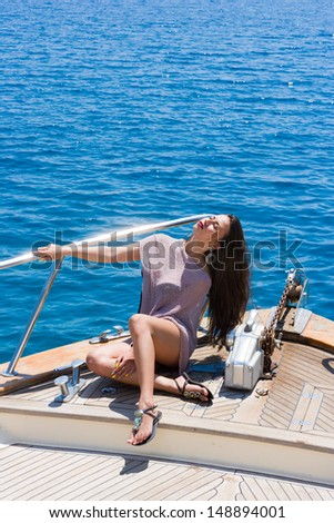 Young sexy woman on her private yacht - stock photo