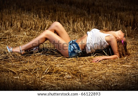 Young sexy woman on summer field. - stock photo