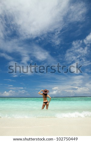 Young sexy woman on the beach - stock photo