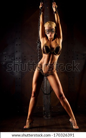 Young sexy woman on wall background. - stock photo