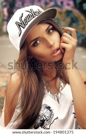 Young sexy woman outdoor portrait in summer in city. Fashion swag dressed in vintage t-shirt. Passion style. - stock photo