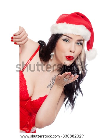 Young sexy woman posing in lingerie with Santa Claus hat, isolated on white - stock photo