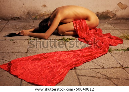 Young sexy woman posing in red - stock photo