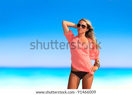 Young sexy woman posing on the beach in Greece
