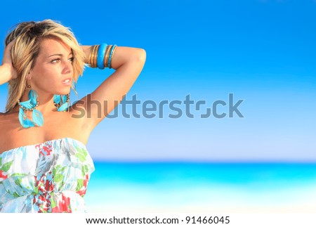 Young sexy woman posing on the beach in Greece - stock photo