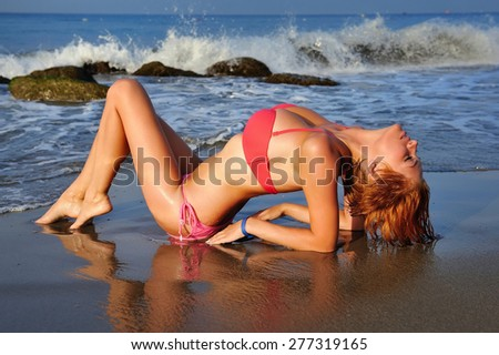 Young sexy woman relaxing on the beach - stock photo