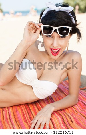 Young sexy woman relaxing on the beach - outdoors - stock photo