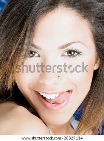 young sexy woman touch her up lip  by tongue, close up - stock photo