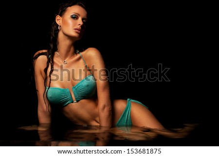 Young sexy woman water studio portrait. - stock photo