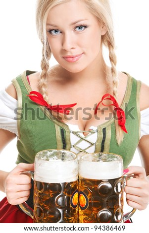 young sexy woman wearing a dirndl with two beer mugs over white