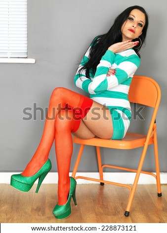 Young Sexy Woman Wearing a Mini Dress Stockings and High Heels - stock photo