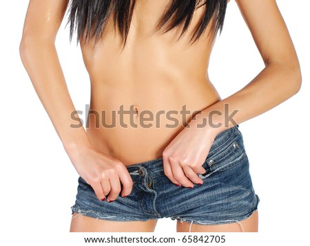 young sexy woman wearing jean shorts - stock photo