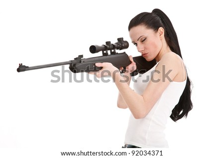 Young sexy woman with a sniper rifle, isolated white background. - stock photo