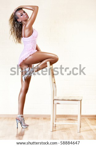Young sexy woman with chair.