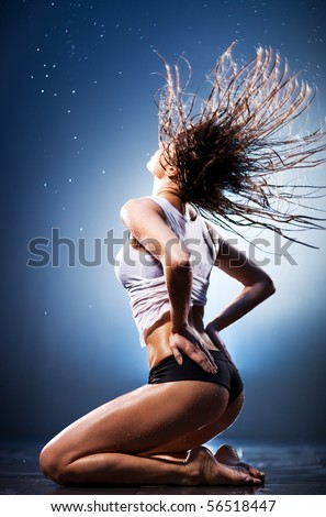 Young sexy woman with fluttering hair. Water studio photo. - stock photo