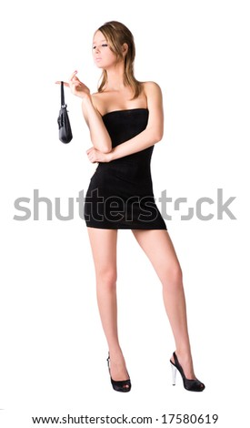 Young sexy woman with handbag. Isolated on white. - stock photo