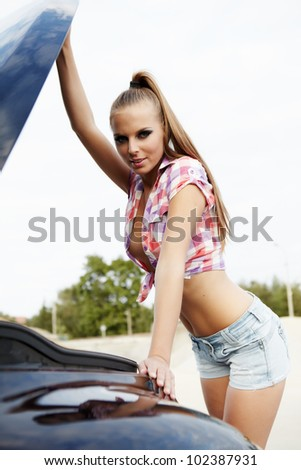 young sexy woman with her broken car. - stock photo