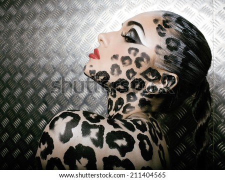 young  sexy woman with leopard make up all over body, cat bodyart - stock photo