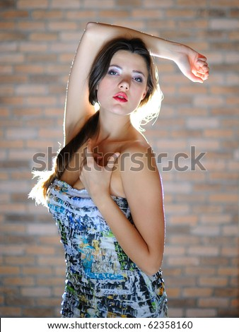 Young sexy woman with long healthy hair and bright  make-up dancing - stock photo