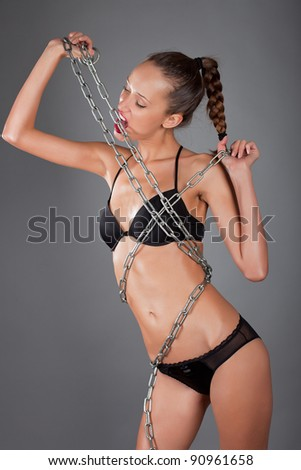 young sexy woman with metall chain - stock photo