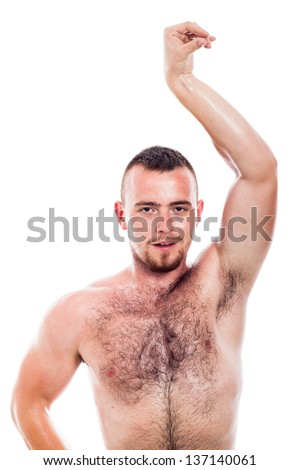 Young shirtless hairy man showing his body, isolated on white background - stock photo