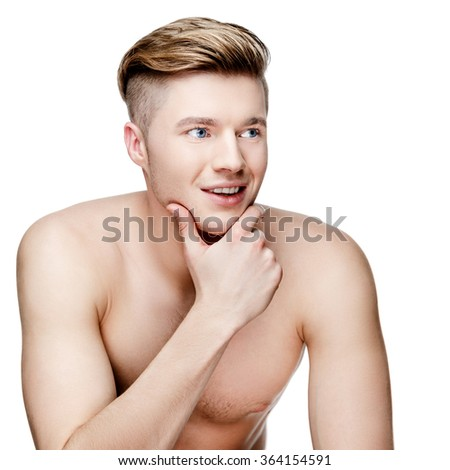 Young shirtless man isolated on white