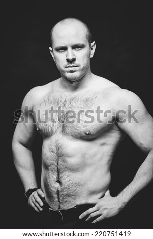 Young shirtless man posing for camera - stock photo