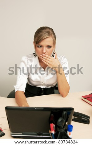 Young shocked girl at office - stock photo