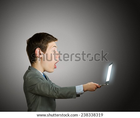 Young shocked man with big head looking in notepad - stock photo