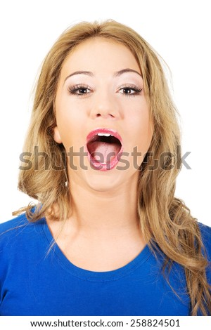 Young shocked woman with opened mouth. - stock photo