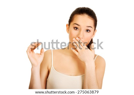 Young shocked woman with pregnancy test.  - stock photo