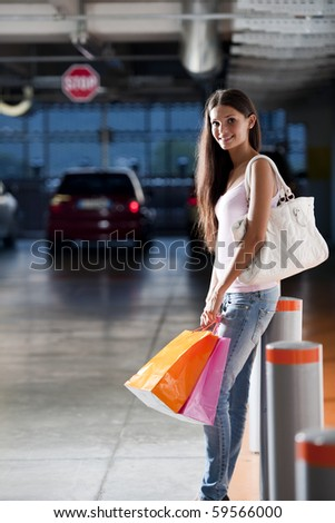Young shopper at underground car park - stock photo