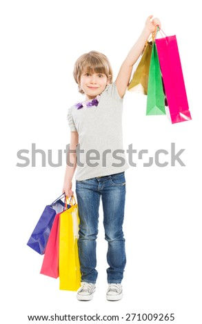 Young shopping girl with shopping bags isolated on white background - stock photo