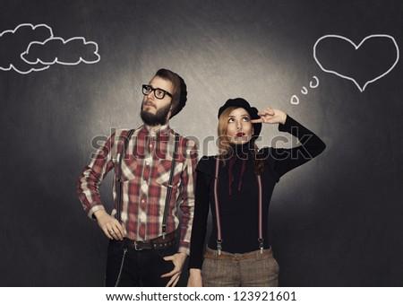 young shy nerds flirting on grunge background - stock photo