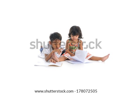 young siblings doing homework, isolate on white background - stock photo