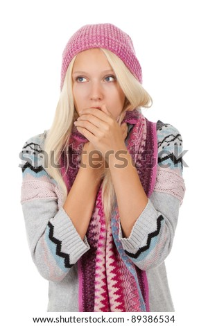 young sick girl got flu or cold, cover mouth by hold hand, wear wear winter knitted pink hat scarf and sweater, isolated over white background - stock photo