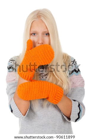 young sick girl got flu or cold, cover mouth by hold hand, wear winter knitted pink hat scarf and sweater, orange gloves, isolated over white background - stock photo