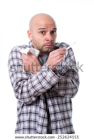 young sick man infected by winter grippe virus feeling unwell holding thermometer reading temperature suffering flu and headache in cold and influenza health care concept - stock photo
