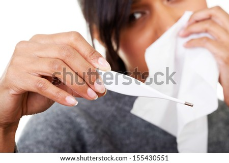Young sick woman checking her temperature , isolated - stock photo
