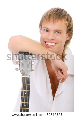 Young singer leans elbows on guitar and laughs - stock photo
