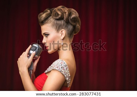 Young singer on the scene - stock photo