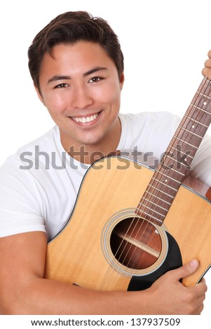 Young singer-songwriter sitting down with an acoustic guitar, wearing a white t-shirt. White background.